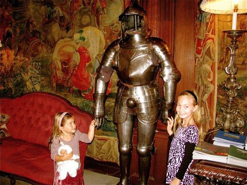 cute girls with knight in armor & tapestries/ Cliveden. UK