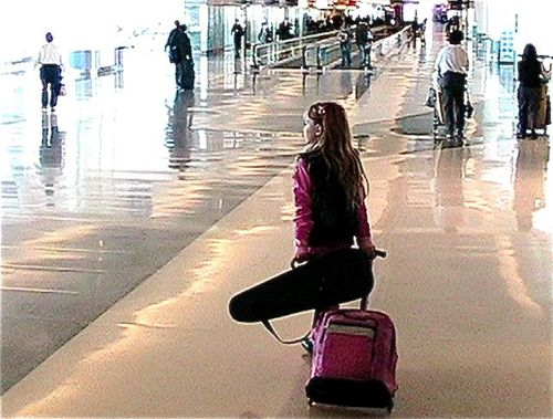 airport travel young girl child with roll bag & violin