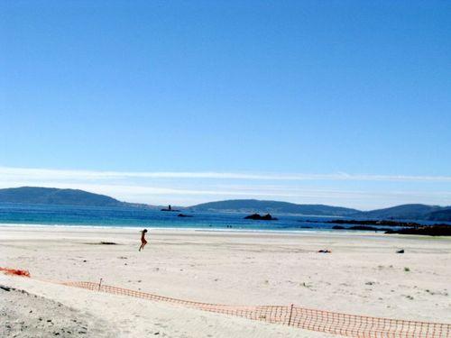 Galicia, beautiful beach, child runing on beach, Spain