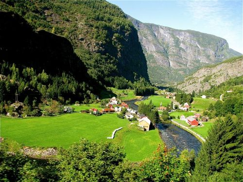 Stunning Norway fjord landscape river near Flam Railway on Norway in a Nutshell mountains & houses
