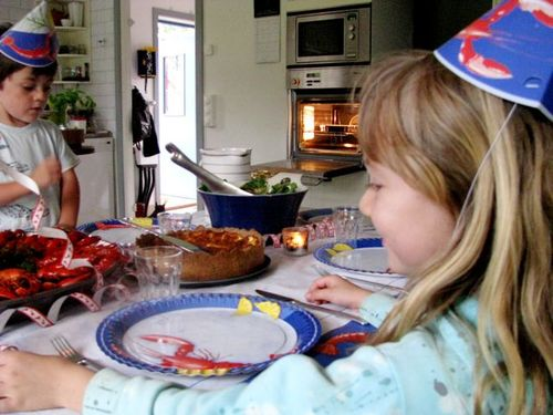Crayfish party sweden, 2 kids in hats, family travel