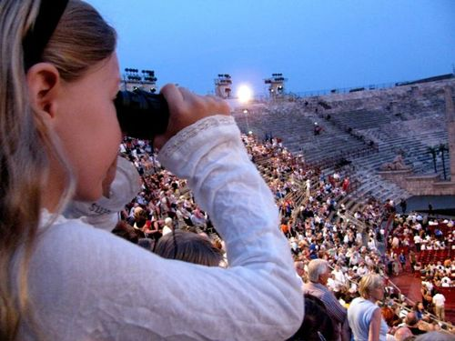 family travel girl watching opera in Verona arena Italy education