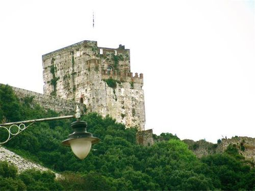Gibraltar Moorish castle with UK flag on daytrip Andalusia, Spain