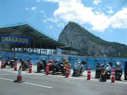 Gibraltar mopeds as one crosses the road from Spain