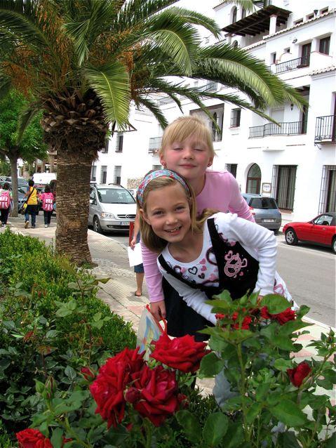 2 cute kids in white village Spain, globe trotting, location independent, global nomad kids! TCK,
