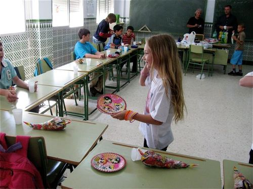 passing out plates and goodies spanish style at school good bye party
