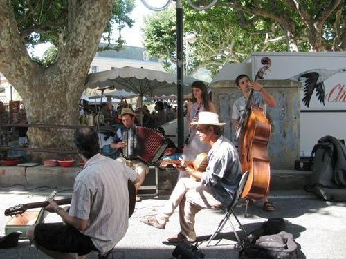 Collioure, France market day French band and Plane trees family travel fun