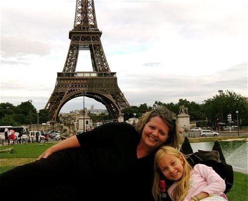 Family travel Paris, mom and daughter at Eiffel towe pinic having fun