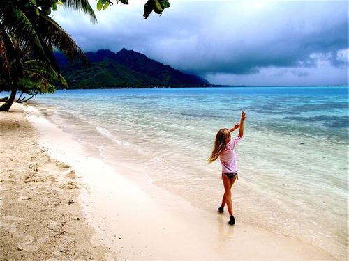 family travel French Polynesia Moorea kid on beach