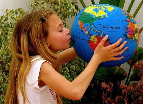 Around the world family travel soultravelers3, girl kissing world globe, loving world,