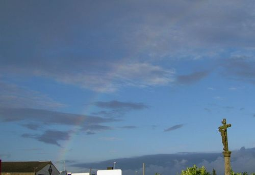 Rainbow and road cross in Roscoff France