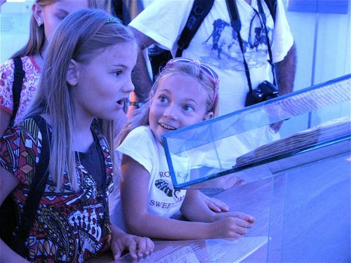 family travel kids having fun and learning in a museum tour