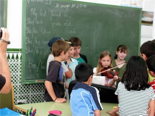 playing violin for classmates