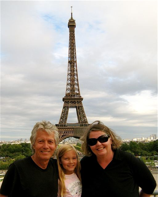 family travel portrait in Paris at Eiffel tower