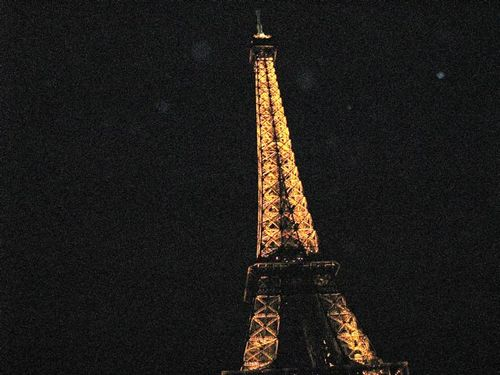 eiffel tower at night by boat Paris france holiday