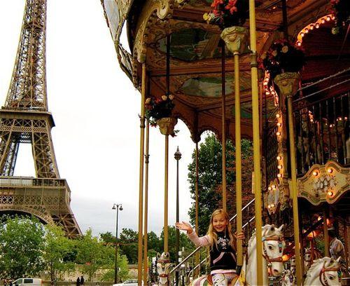 family travel paris eiffel tower merry go round