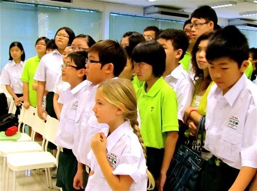 our blond daughter first day at Mandarin Chinese school in Asia