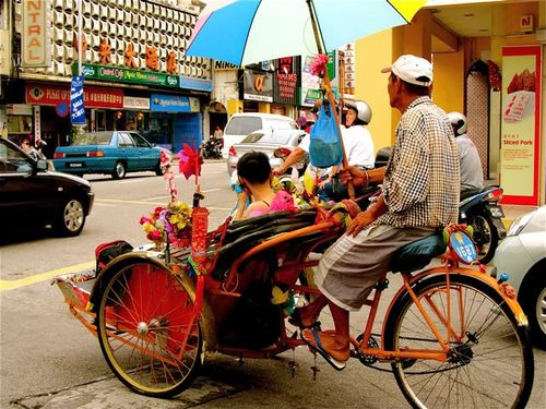 family travel asia rickshaw ride photo in georgetown, penang, Malaysia