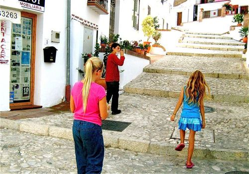 Spain village. After a summer away traveling, kids enjoy reconnecting & time to catch up