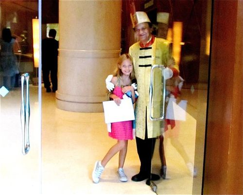doorman at the fairmont singapore greeting warmly in traditional dress