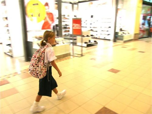 happy to be in the penang mall with her Chinese school uniform on!