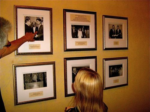 Pointing to photo of JFK at the Fairmont San Francisco Hotel