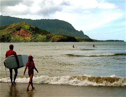surfer girl and puff the magic dragon in Hanalei Bay