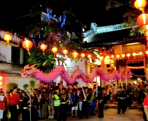 Chinese New Year dragon dance in ancient temple