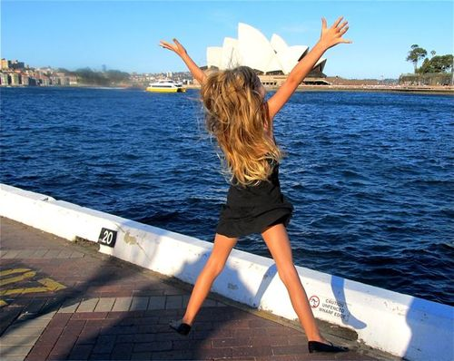 jumping for joy is Sydney near opera house