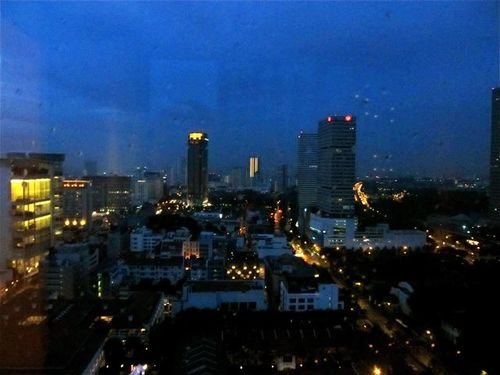beautiful cityscape at night from our tower room at Fairmont Singapore