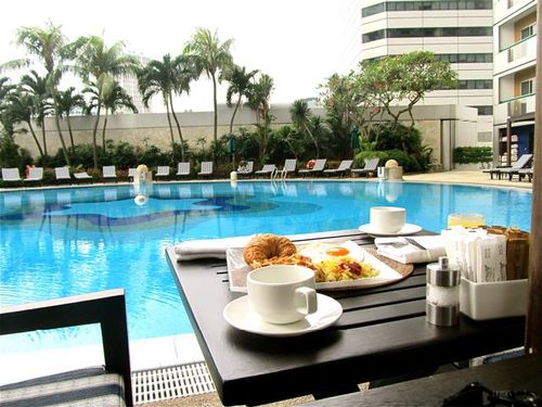 pool breakfast view singapore fairmont