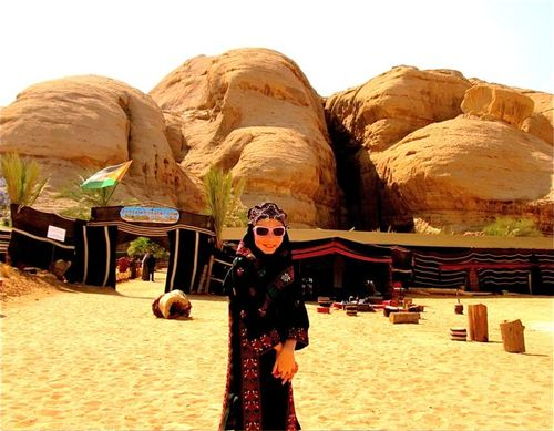 Our Bedouin at Wadi Rum in tradional clothes and sunglasses