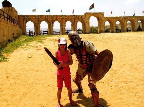 Jerash family travel fighting a gladiator in Jordan