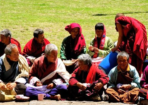 Bhutan culture -locals celebrating at a Buddhist monastery