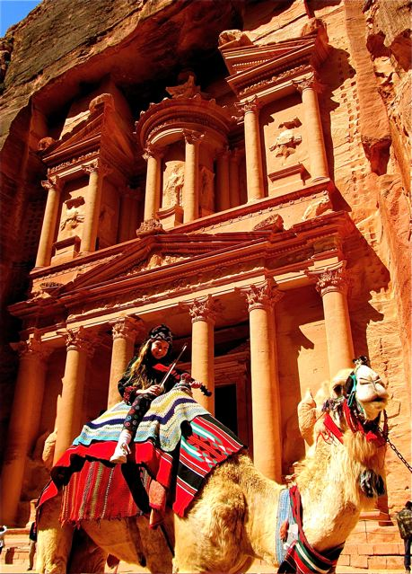 Our girl playing violin on camel at Petra