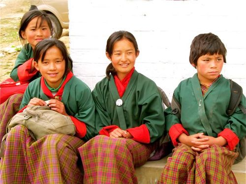 school kids in Bhtuan in traditional school uniforms