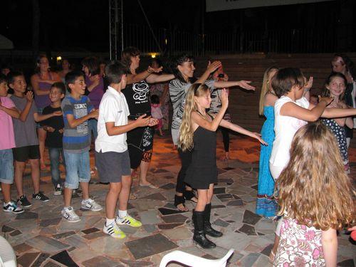family fun= kids doing macarena at kids disco in Europe