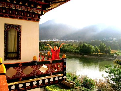 Bhutan -waking up to mist, sunshine, beautiful mountain & river views & hand painted architecture