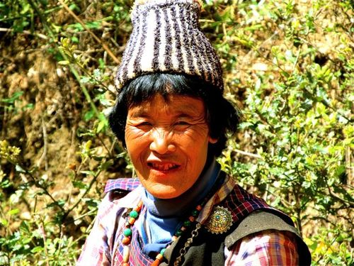 "Bhutan woman with ""doma"" red smile from beetlenut/lime treats"