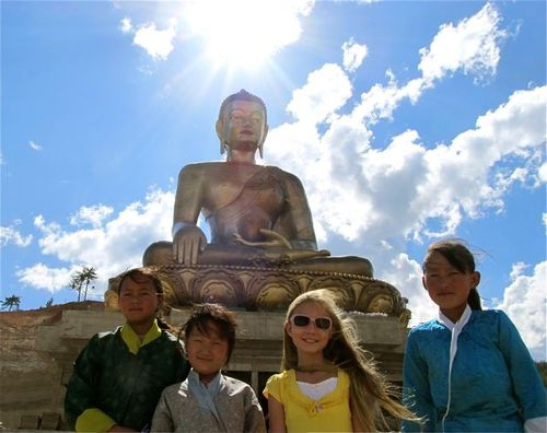 meeting friends near giant buddha in Bhutan