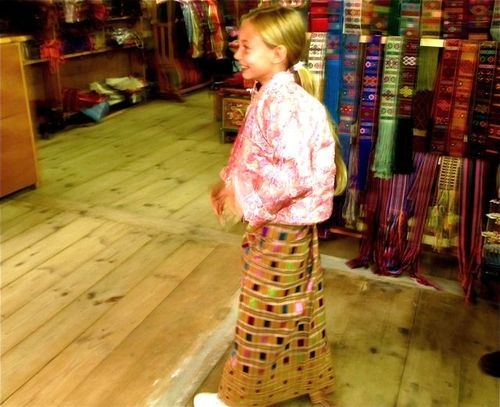 our girl in Bhutan trying on the elegant traditonal Bhutanese dress called Kiras