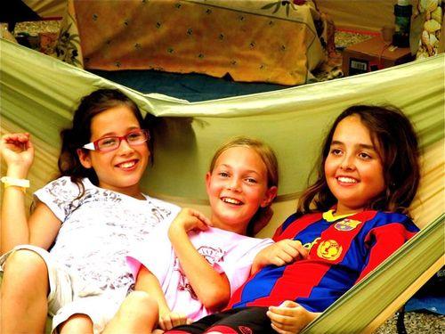 3 happy kids in a hammock