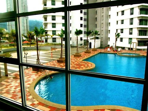 Our rental condo pool and play area in Penang