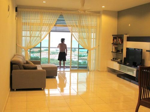 Enjoying the peaceful sea views in our new rental apartment in Penang