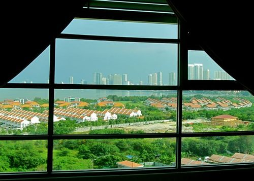 Sea, cityscape, tile roof and green space views in Penang