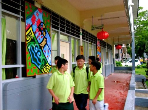 boys walking the outdoor halls of our Penang Chinese school
