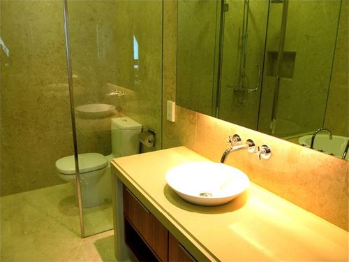 Typical bathroom in upper end Penang rental apartment