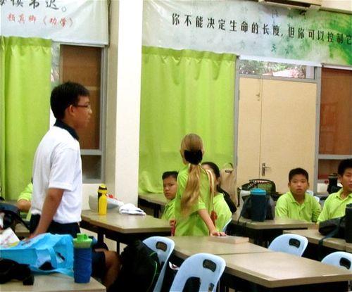 America kid enjoying  a Chinese school in Asia