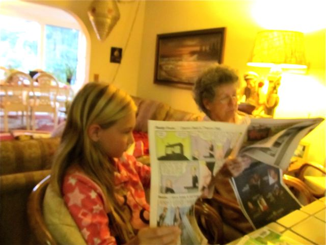 Old Media...Grandma and grandchild reading the Sunday paper