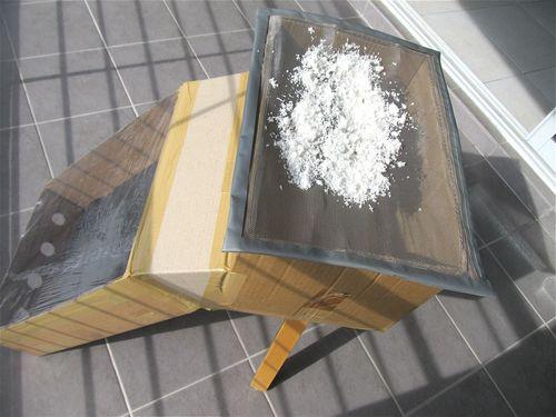 homemade dehydrator drying fresh shredded coconut for flour